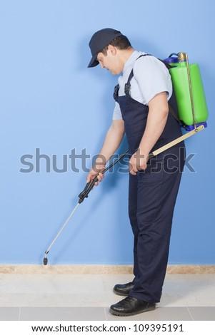 gardener is Spraying - stock photo