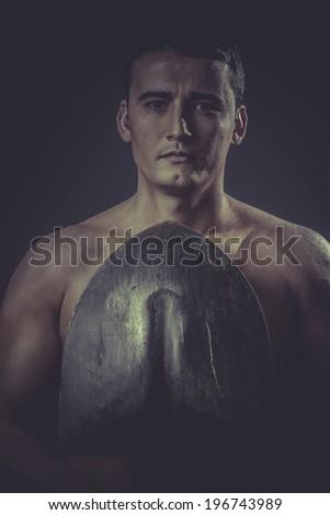Gardener .Male worker holding a shovel, sexy builder - stock photo