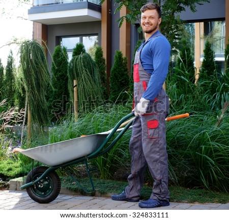Gardener with tools in garden - stock photo