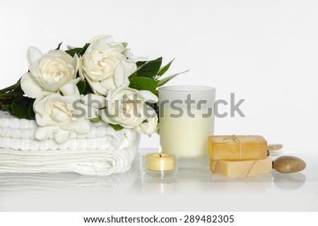 gardenia on towel and spa sitting - stock photo