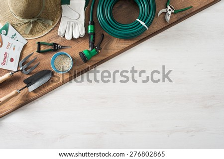 Gardening and farming tools on a wooden table with blank copy space, top view - stock photo