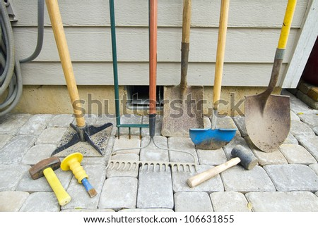 Gardening and Landscaping Tools for Yard and Pavers Hardscape Work - stock photo