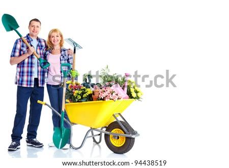 Gardening couple with rake and shovel. Isolated over white background. - stock photo