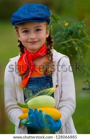 Gardening, gardener, child - lovely girl with picked vegetables - stock photo