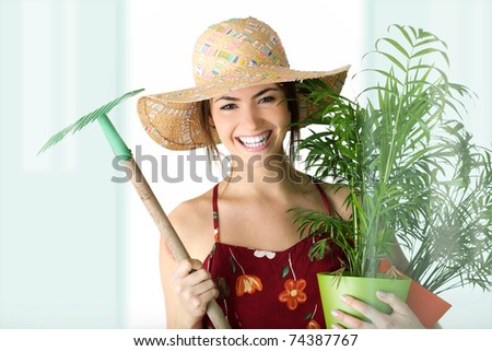 gardening girl portrait with plant - stock photo