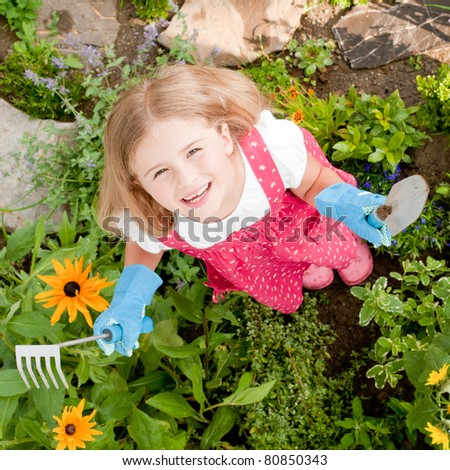Gardening - girl working in the garden - stock photo