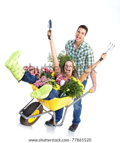 Gardening. Happy couple with flowers. Isolated over white background - stock photo