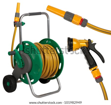 Gardening hose with nozzles isolated on white background - stock photo