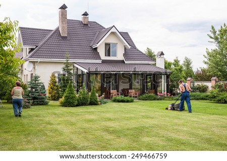 gardening of a private house in spring - stock photo