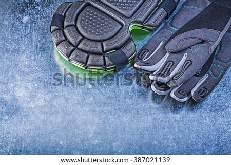 Gardening safety gloves knee protectors on metallic background agriculture concept. - stock photo