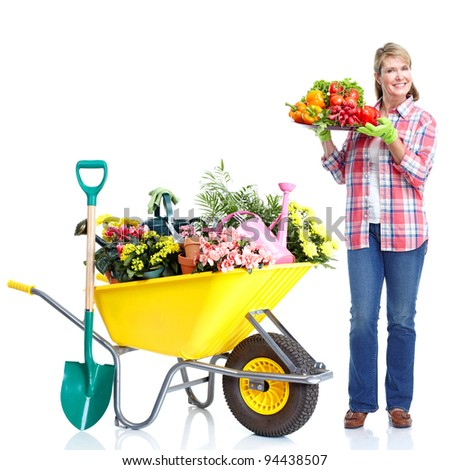 Gardening. Senior woman with vegetables. Isolated over white background.