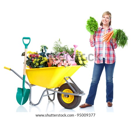 Gardening. Senior woman with vegetables. Isolated over white background. - stock photo