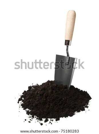 Gardening spade in soil isolated on white - stock photo