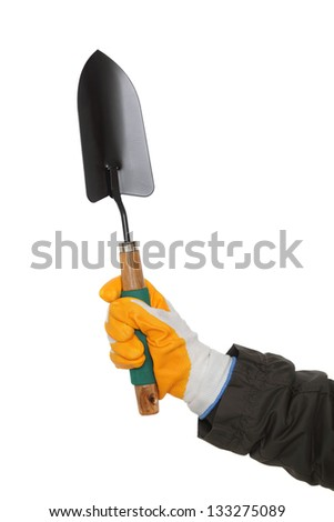 Gardening spade or trowel in human hand with protective gloves