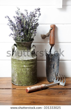 gardening still life with old vase in white wall background - stock photo