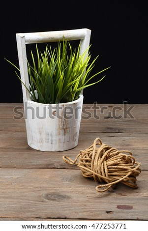 gardening tools and grass on wooden table