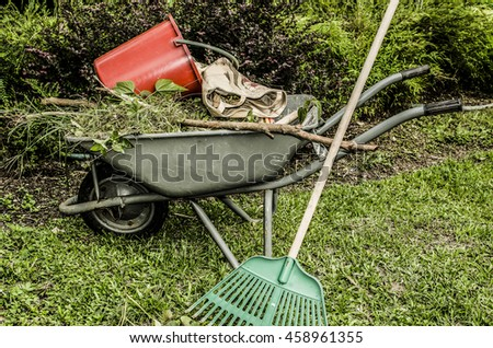Gardening tools and utensils for maintaining public parks and amenities / Garden tools / Common tools like wheelbarrows, rake, buckets, hand spades, and hard brooms made from coconut leaf midrib