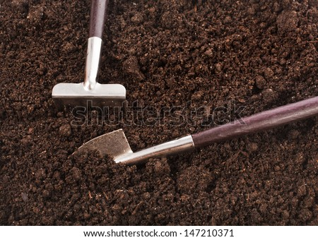 gardening tools  in soil surface top view background  - stock photo