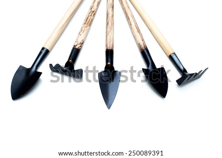 Gardening tools on a white background.