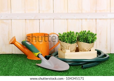 Gardening tools on wooden background