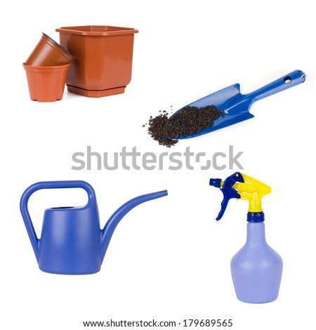 Gardening tools set: watering can, spray bottle, flowerpots and shovel with soil - stock photo