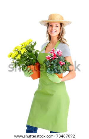 Gardening. Woman worker with flowers. Isolated over white background - stock photo