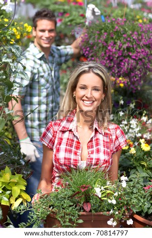 Gardening. Young smiling people florists working in the garden.