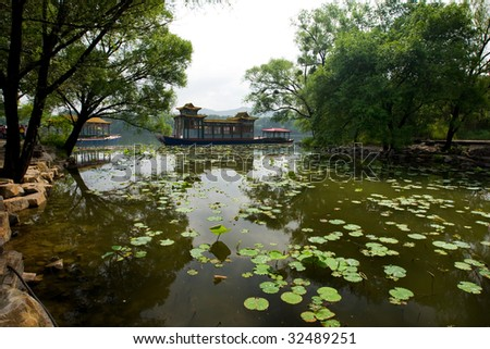 Gardens, boat and lake at the Summer Resort in Chengde, China