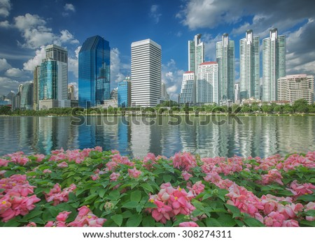 Gardent in bangkok city with flower and river