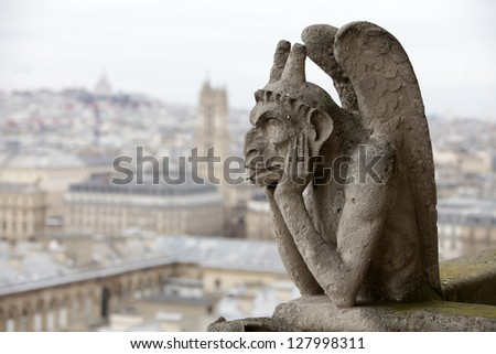 Gargoyle (chimera) on Notre Dame de Paris close up - stock photo