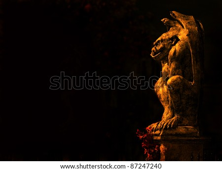 Gargoyle isolated on black background - stock photo