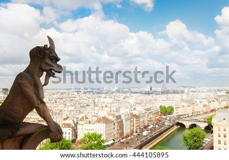 Gargoyle of Paris on Notre Dame Cathedral church and Paris cityscape, France, retro toned