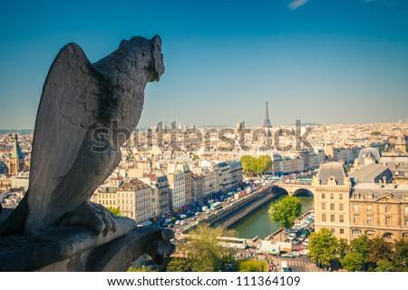 Gargoyle on Notre Dame Cathedral, Paris, France - stock photo