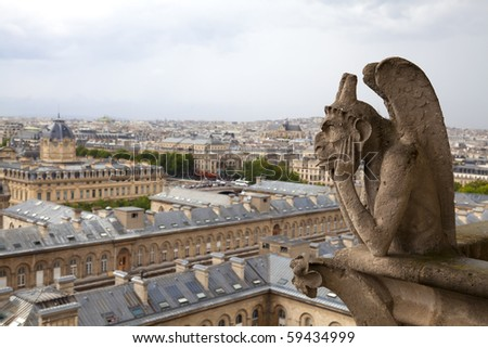 Gargoyle on the Notre Dame cathedral in Paris - stock photo