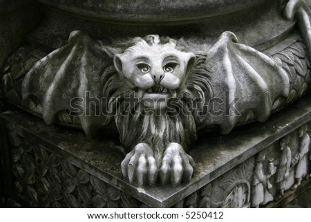 gargoyle statue on pillar - stock photo