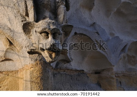 Gargoyles at the top of Pey-Berland tower, Cathedral Saint André, Bordeaux, France - stock photo
