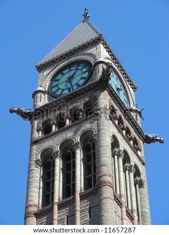 Gargoyles on the clock tower of Old City Hall, Toronto, Canada. - stock photo