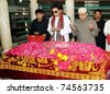 GARHI KHUDA BUX, PAKISTAN, APR 03:  Asif Ali Zardari along with Bilawal Bhutto Zardari Chairman of Peoples Party offer Dua (pray) at the Grave of Benazir Bhutto on April 03, 2011 in Ghari Khuda Bux, Pakistan. - stock photo