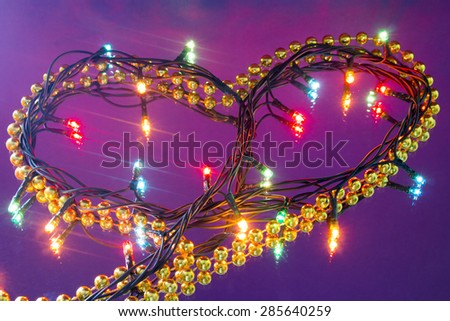 Garland in the form of heart on the mirror - stock photo