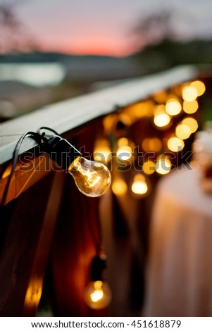 garland of light bulbs in wedding decor - stock photo