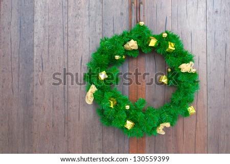 garland on wooden door - stock photo