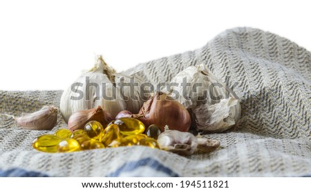 Garlic and drug pills , isolated on white background - stock photo