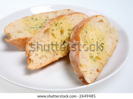 Garlic and herb bread - stock photo