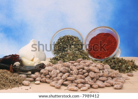 Garlic and Other Spices on Blue Textured Background, Shallow DOF - stock photo