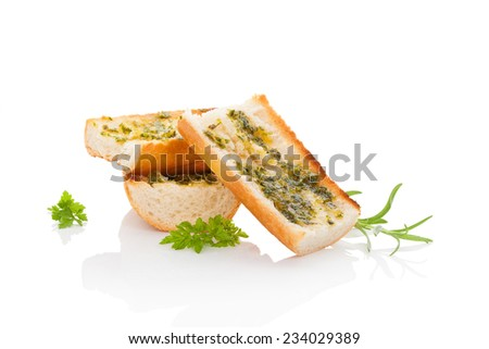 Garlic baguette isolated on white background with fresh herbs. Culinary baguette eating.  - stock photo