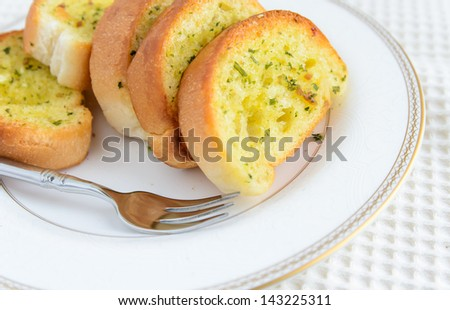 Garlic bread on the plate. - stock photo