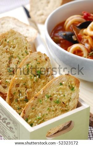 Garlic bread with bouillabaisse - stock photo