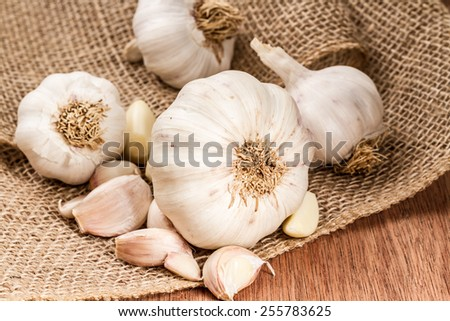 garlic bulbs with garlic cloves  - stock photo