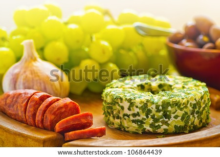 Garlic cheese on a wooden plate - stock photo