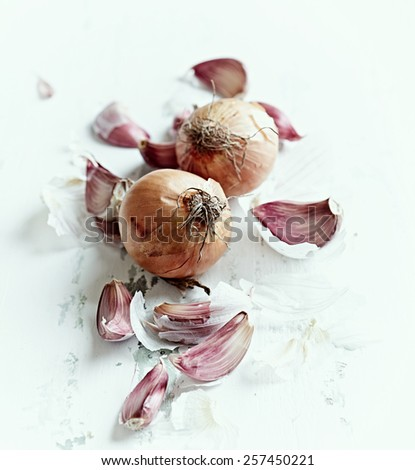 Garlic cloves and onions  - stock photo
